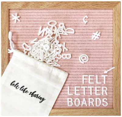 This is an image of girl's letter board in pink and brown colors