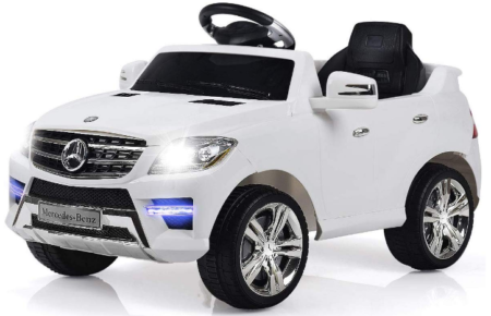 This is an image of girl's power wheels mercedes in white color