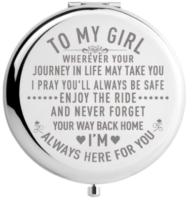 This is an image of girl's small circle mirror with engraved with words in silver color
