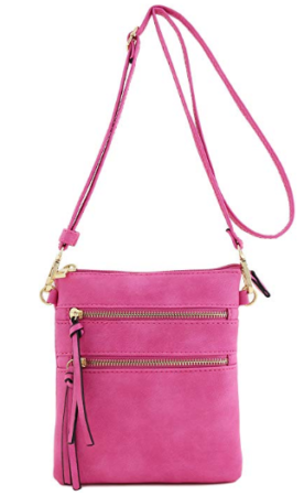 This is an image of girl's multi pocket crossbody bag in pink color