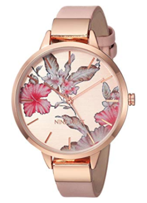 This is an image of a pink floral watch for women by Nine West.