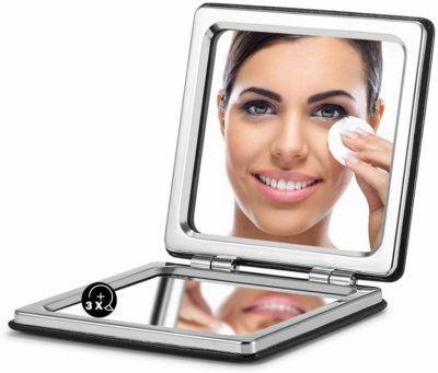 This is an image of a black compact purse mirror for women by Omiro.