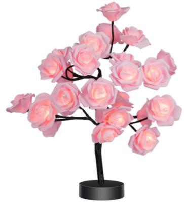 This is an image of girl's rose flower lamp in pink color
