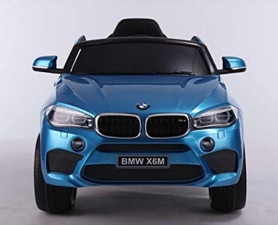 This is an image of girl's power wheels BMW in blue color