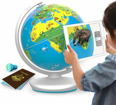 This is an image of a child using an educational interactive globe by Shifu.