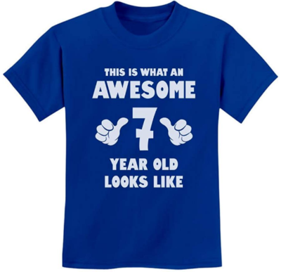 This is an image of boy's T shirt with 7 year old writing on it in blue color