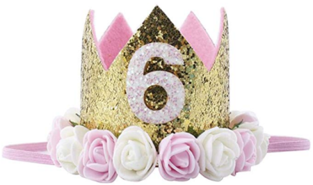 This is an image of girl's 6th golden crown with flowers in colorful colors