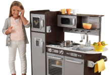 This is an image of girl's espresso kitchen in grey and black colors