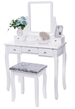 This is an image of girl's vanity set with chair and mirror in white color