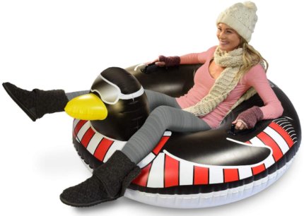 This is an image of kid's inflatable snow sled with penguin design in black and white colors