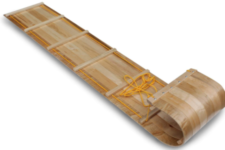 This is an image of kid's wood snow sled