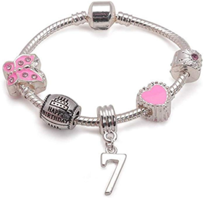 This is an image of girl's charm bracelet with 7 years old number in silver and pink color