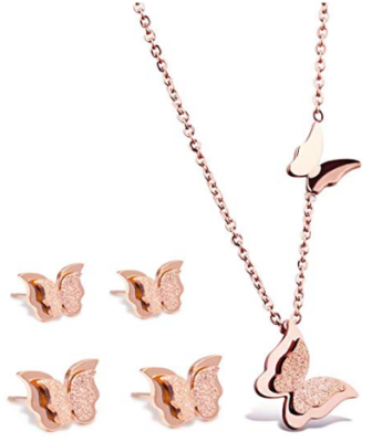 This is an image of girl's necklace and rings with butterfly design in pink color
