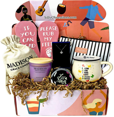 This is an image of mom's gift box containing mugs and various gifts such as slippers and skincare products
