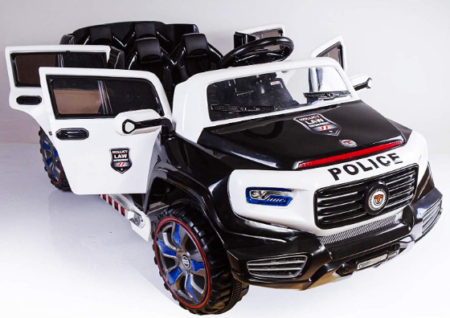 This is an image of girl's power wheels car with police theme in white and black colors