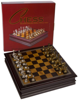 This is an image of boy's wooden chess board game with metal pieces