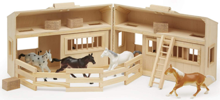 This is an image of kid's wooden horse stable toys in colorful colors