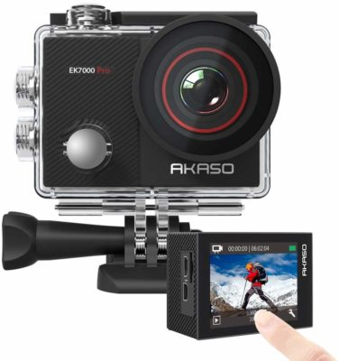 This is an image of a black action camera with accessories kit.