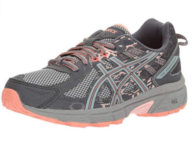 This is an image of a mid grey and seashell fish colored running shoe for women.