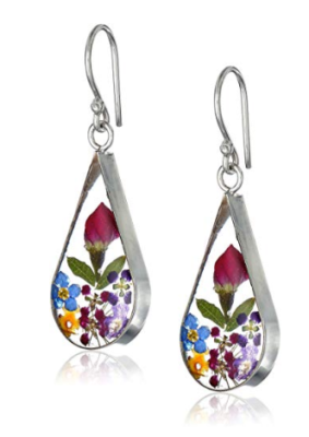 This is an image of a teardrop shaped earrings with pressed flower earrings .