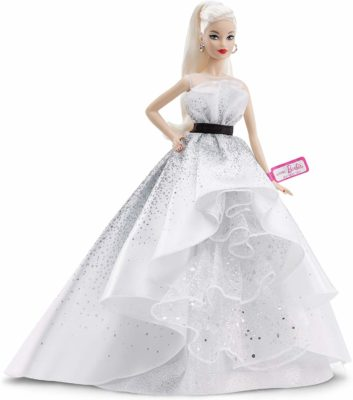 This is an image of a blode barbie doll wearing a white diamond inspired gown.