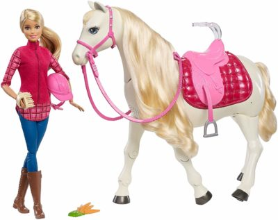 This is an image of a Barbie doll with her dreamhorse doll.