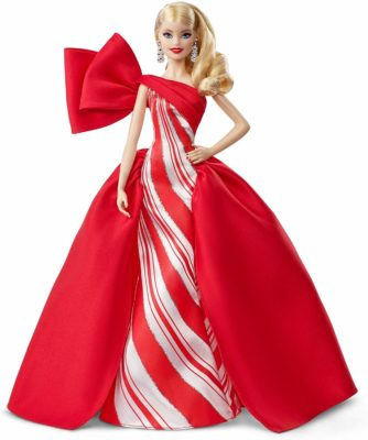 This is an image of a blonde holiday barbie doll wearing a red gown.