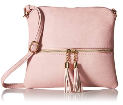 This is an image of a blush colored crossbody bag with tassel for teens.