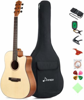 This is an image of an acoustic guitar with gig bag, capo, tuner, picks. strap and guitar strings.