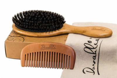 This is an image of a wooden hair brush set for women.