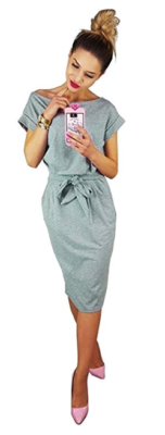 This is an image of a teenage girl wearing a grey pencil dress while taking selfie.