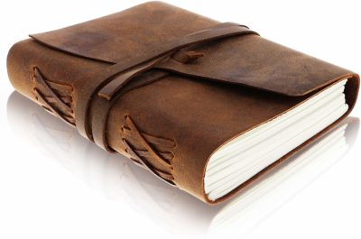 This is an image of a brown leather journal for men by Moonster.