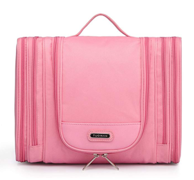 This is an image of a pink hanging toiletry travel bag for teens.