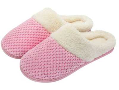 This is an image of a pink fuzzy plush slippers for women.