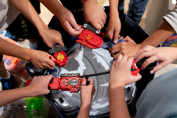 this is an image of people playing beyblade