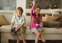 This is an image of Children playing playstation.