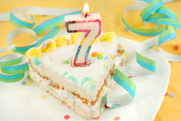 this is an image of a cake with a 7th birthday candle on it