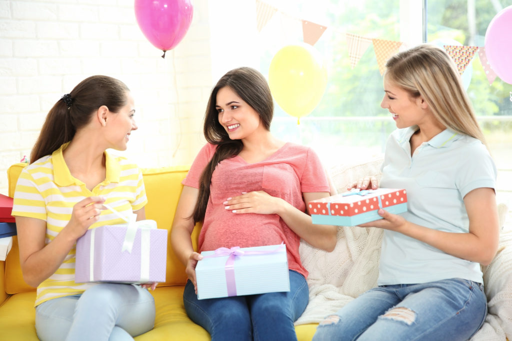 this is an image of moms exchanging gifts