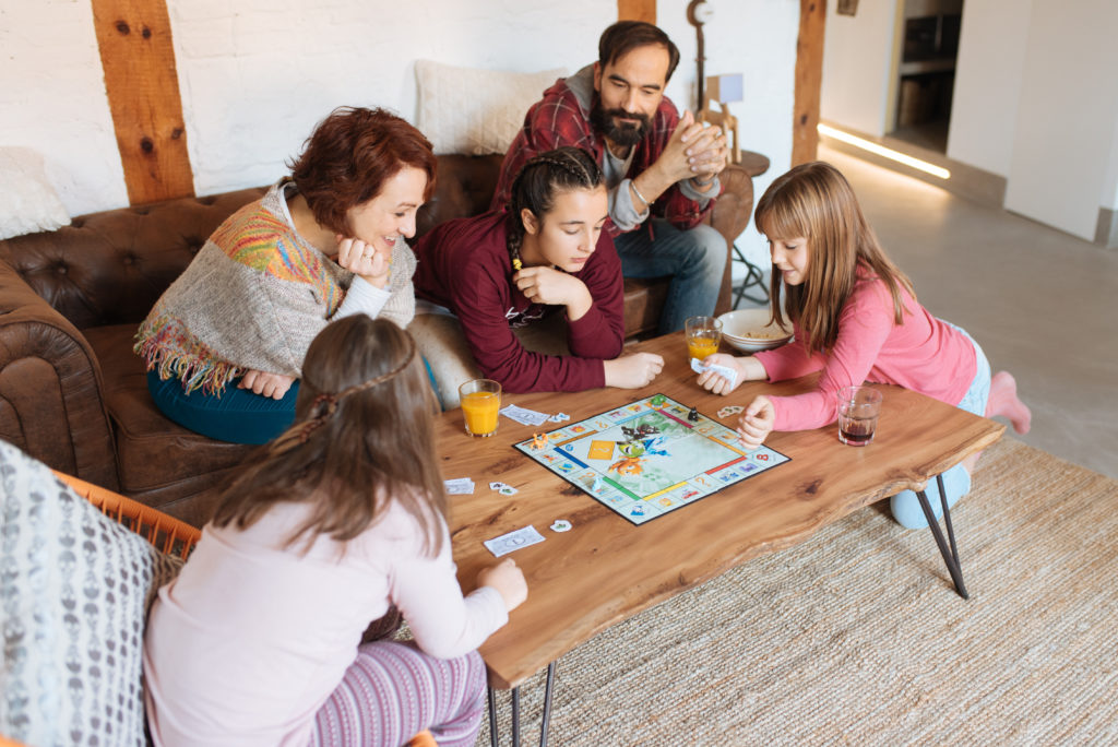 this is an image of a family playing board games