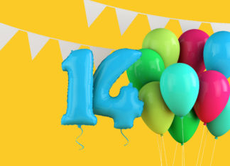 This is an image of a Happy 14th birthday colorful party balloons and bunting