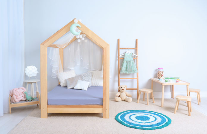 this is an image of a toddlers room with toddler bed