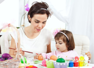 this is an image of a 1 year old girl painting crafts